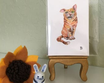 Mini original watercolor painting of a crazy cat. Small original artwork cat the perfect lighthearted gift. Ginger moggy art home decor