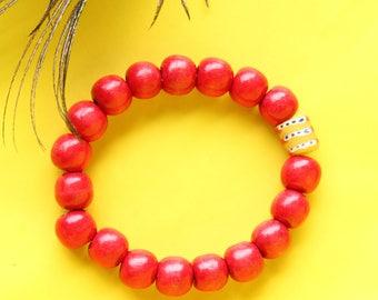 Glossy red wooden bead bracelet with Krobo free trade glass bead, Beaded bracelets for Women