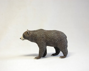 Brown grizzly bear wild animal figurine