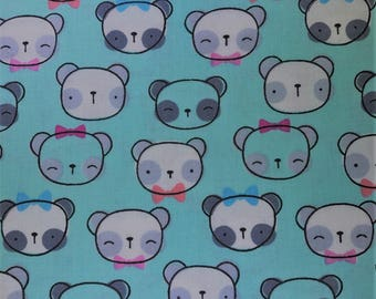 Fabric with bears heads.