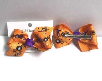Spiders on orange halloween hair bow clip