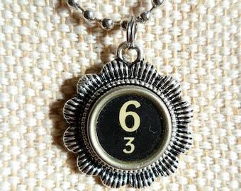 Adding machine key 6 and 3 necklace with flower surround/ typewriter key pendant / silvertone flower pendant