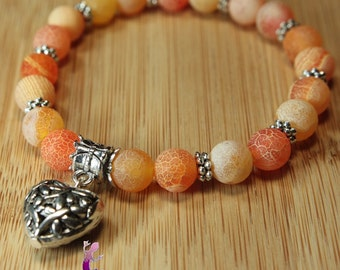 Bracelet agate dyed orange with heart charm in silver metal charm