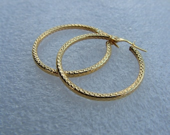 gold hoops in 9 carat yellow gold medium size (3cm in diameter)