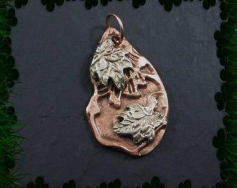 Chrome bronze leaves on copper pendant