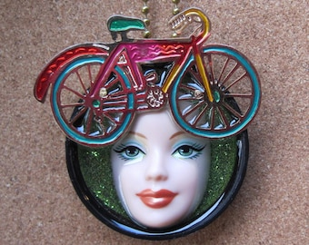 I LIKE MY BIKE - upcycled Barbie Doll face pendant