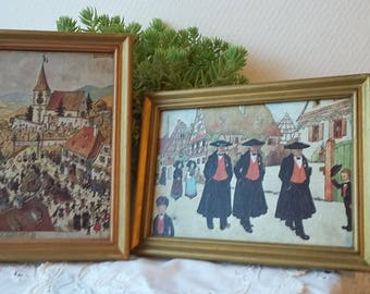 Set  of 2 paintings of Alsace vintage reproduction engravings of the artist Hansi Gilt wood frame