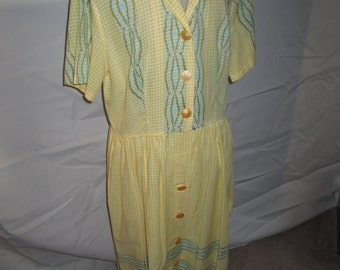 1950s cotton day dress pale lemon with cross stitch print