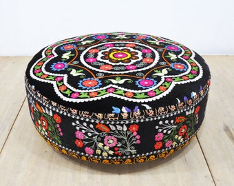 Suzani round ottoman - black magic