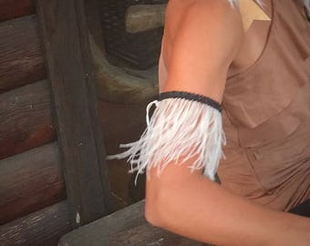White ostrich beaded arm cuff.