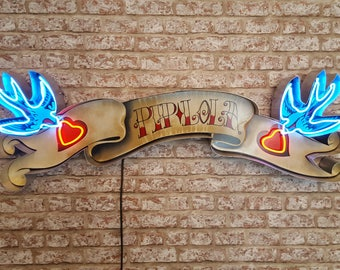Neon Scroll sign.