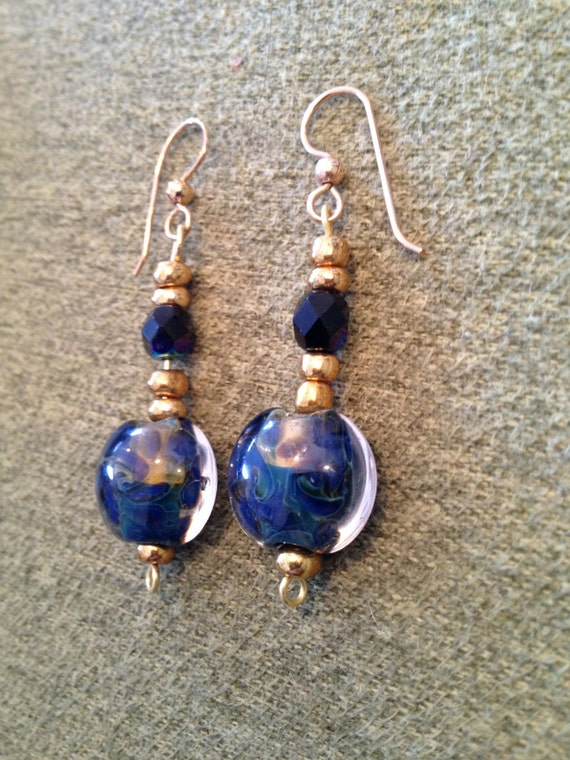 SJC10048 - Earrings with lampwork blue and gold Mediterranean lentil design glass beads, gold seed beads and dark blue Swarovski crystal