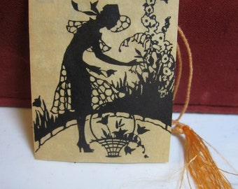 1920's-30's art deco P.F. Volland bridge tally card silhouette of deco lady in garden with basket unused