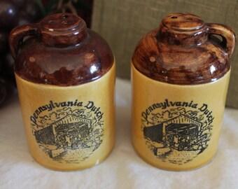 Pennsylvania Dutch Moonshine Jug Ceramic Salt and Pepper Shakers - Souvenirs