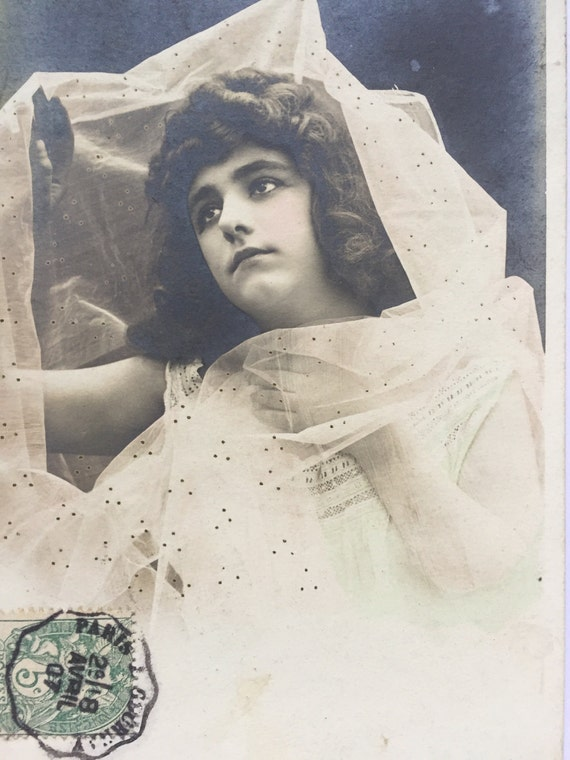 1900s French Postcard Of Sad Looking Vintage Girl Wearing The