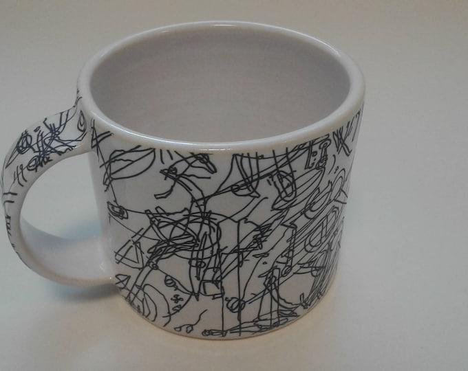 Ceramic mug by Gosia Wlodarczak in collaboration with Maria Lieberman