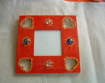Frame the Red brimmed with hollowed hearts and worm beads