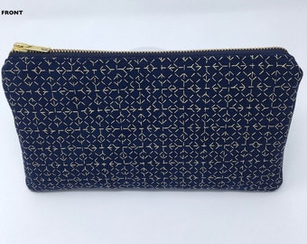 Sashiko embroidered faux-suede clutch