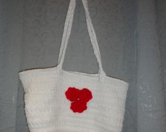 Sasha's crochet bag with red flowers