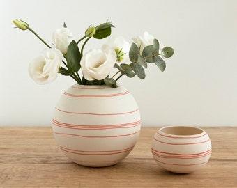 porcelain vase with orange red decorative stripes . handmade round ceramic vessel red lines. handcrafted porcelain by Wapa Studio