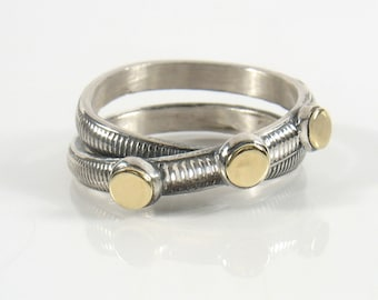 Sterling silver infinity shape, banded and oxidized with three gold dots on top