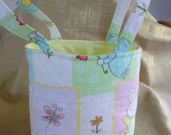 Easter Basket. Bunny Buddies print with Yellow lining. Two Handles. approx 13.5 cm wide x 8 cm deep x 14 cm high.