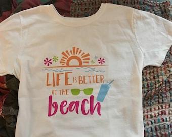 "Women's T-shirt ""Life is Better At The Beach"""