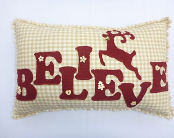 Rustic Christmas pillow/cushion. Homespun fabrics, rag quilted with 'believe' and reindeer applique.