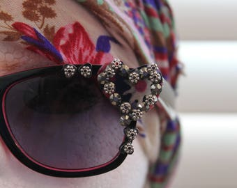 Heart-embellished sunglasses.  Wear your heart on your sunglasses, not your sleeve....