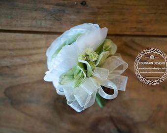 White ranunculus, hydrangea green accent corsage