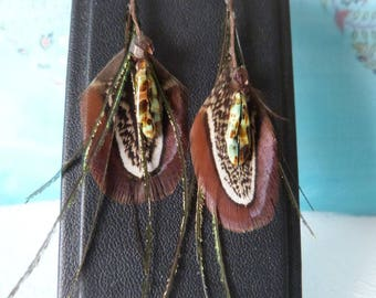 Beards of peacock feathers and dark green beads earrings