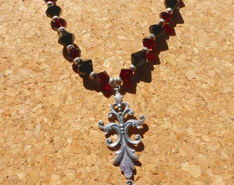 black and garnet red crystal necklace and earrings with fancy silver pendant