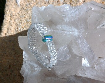 Turquoise and silver beadwork ring
