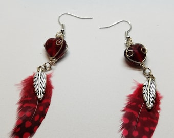Red Guinea feathers w/large glass wired bead and feather charm
