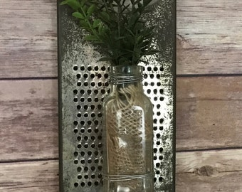 Re-purposed antique, Vintage Cheese Grater, with glass bottle and greenery