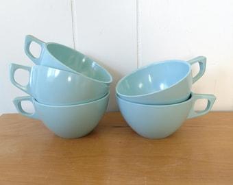 vintage light aqua blue melmac cups