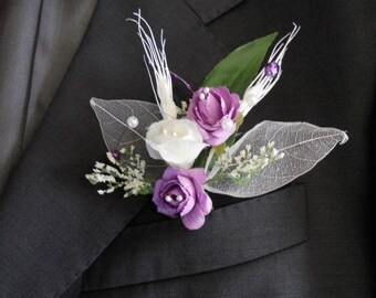 Purple and white wedding boutonniere