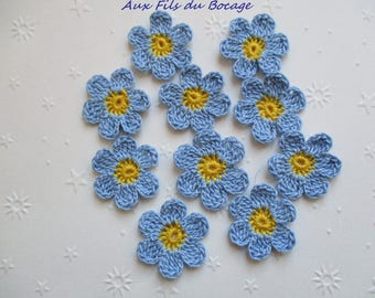 Crocheted set of 10 sky blue and yellow flowers, appliques.