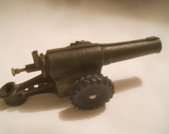 Toy canon with firing pin and calside