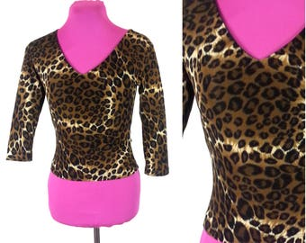 Small Leopard Print Top / vintage animal print quarter length sleeves patterned polyester knit 90s womens clothing 1990s black and brown top