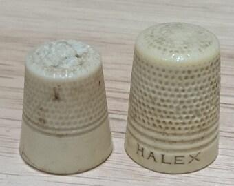 Two vintage bone thimbles