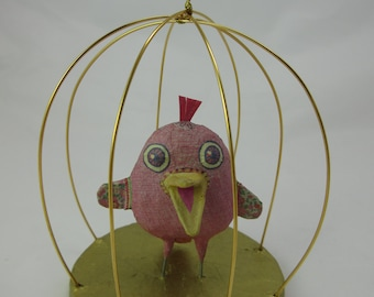 Jolly Pink Fabulous Bird In Gold Guilded Cage
