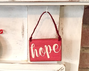 Small wooden hope sign