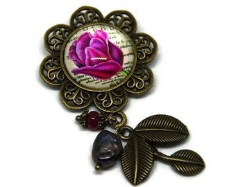 Floral brooch, fuchsia pink and iridescent purple beads and leaves