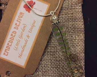 Little Garden No.3 - Scottish wild plant embedded in resin on a silver look snake chain.