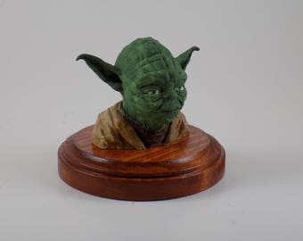 Small Yoda Bust on stained wood base