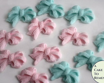 12 pink and blue sugar bows for gender reveal party cupcake decorations. Fondant bows to decorate baby shower cakes or cake pops.