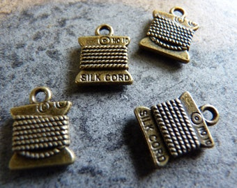 bronze wire coils 4 charms