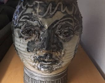 Folk art ugly face stoneware pottery jug