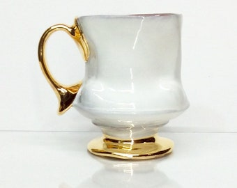 white mug with gold two finger handle